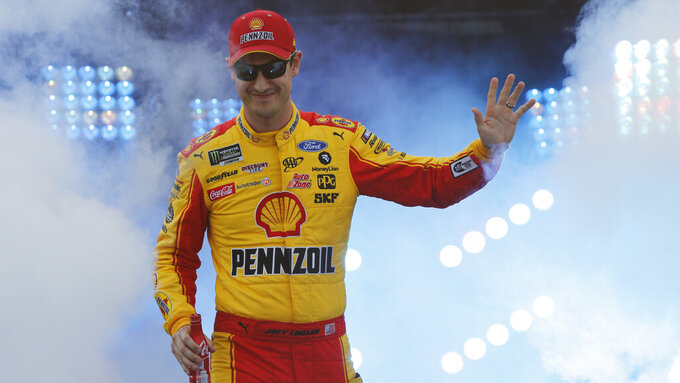 Joey Logano waves to fans during driver introductions prior to the start of the NASCAR Cup series auto race at Richmond Raceway in Richmond, Va., Saturday, April 13, 2019. (AP Photo/Steve Helber)