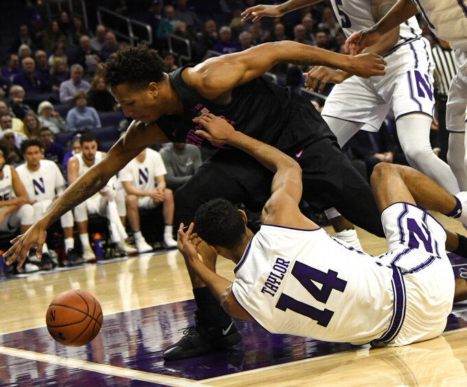 Penn State forward Lamar Stevens, left, and Northwestern guard Ryan Taylor, right, go for a loose ball during the first half of an NCAA college basketball game Monday, Feb. 4, 2019, in Evanston, Ill. (AP Photo/David Banks)