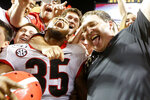 Georgia running back Brian Herrien (35) and head coach Kirby Smart celebrate in the stands after defeating Tennessee in an NCAA college football game Saturday, Oct. 5, 2019, in Knoxville, Tenn. (C.B. Schmelter/Chattanooga Times Free Press via AP)
