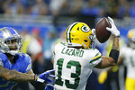 Green Bay Packers wide receiver Allen Lazard (13), defended by Detroit Lions cornerback Darius Slay (23), catches a 28-yard pass for a touchdown during the second half of an NFL football game, Sunday, Dec. 29, 2019, in Detroit. (AP Photo/Duane Burleson)
