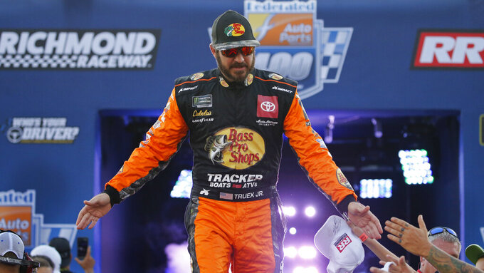 Martin Truex Jr., greets fans during driver introductions for the NASCAR Monster Energy Cup series auto race at Richmond Raceway in Richmond, Va., Saturday, Sept. 21, 2019. (AP Photo/Steve Helber)