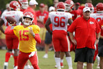 FILE - in this Aug. 2, 2019, file photo, Kansas City Chiefs quarterback Patrick Mahomes (15) throws as coach Andy Reid watches during NFL football training camp in St. Joseph, Mo. Mahomes is expected to get a series or two with the rest of the starters during a preseason game against the Cincinnati Bengals. (AP Photo/Charlie Riedel, File)