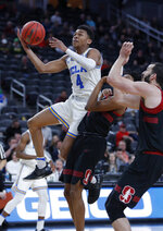 UCLA's Jaylen Hands shoots around Stanford's Marcus Sheffield, center, and Josh Sharma during the first half of an NCAA college basketball game in the first round of the Pac-12 men's tournament, Wednesday, March 13, 2019, in Las Vegas. (AP Photo/John Locher)