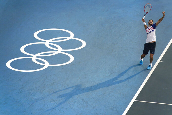 Marin Cilic, of Croatia, plays Pablo Carreno Busta, of Spain, during the second round of the tennis competition at the 2020 Summer Olympics, Monday, July 26, 2021, in Tokyo, Japan. (AP Photo/Seth Wenig)