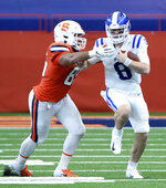 Duke quarterback Chase Brice (8) runs against Syracuse's Josh Black during an NCAA college football game,  Saturday, Oct 10, 2020, at the Carrier Dome in Syracuse, N.Y. (Dennis Nett/The Post-Standard via AP)