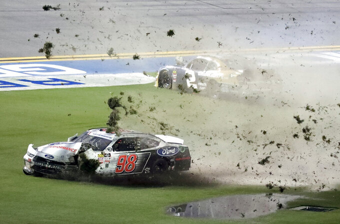Chase Briscoe (98) and Tyler Reddick (2) slide through the infield after they wrecked coming out of Turn 4 during a NASCAR Xfinity Series auto race at Daytona International Speedway, Friday, July 5, 2019, in Daytona Beach, Fla. (AP Photo/John Raoux)