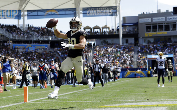 New Orleans Saints wide receiver Austin Carr, left, runs into the end zone for a touchdown during the second half of a preseason NFL football game against the Los Angeles Chargers, Sunday, Aug. 18, 2019, in Carson, Calif. (AP Photo/Gregory Bull )