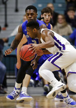 Abilene Christian guard Jaylen Franklin, front, drives around New Orleans guard Troy Green, back, during the first half of an NCAA college basketball game for the Southland Conference men's tournament title Saturday, March 16, 2019, in Katy, Texas. (AP Photo/Michael Wyke)