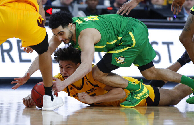 Oregon's Ehab Amin, right, and Arizona State's Taeshon Cherry scramble for the ball during the second half of an NCAA college basketball game in the semifinals of the Pac-12 men's tournament Friday, March 15, 2019, in Las Vegas. (AP Photo/John Locher)