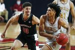 Boston College's Demarr Langford Jr. (15) drives past Louisville's Samuell Williamson (10) during the second half of an NCAA college basketball game, Saturday, Jan. 2, 2021, in Boston. (AP Photo/Michael Dwyer)