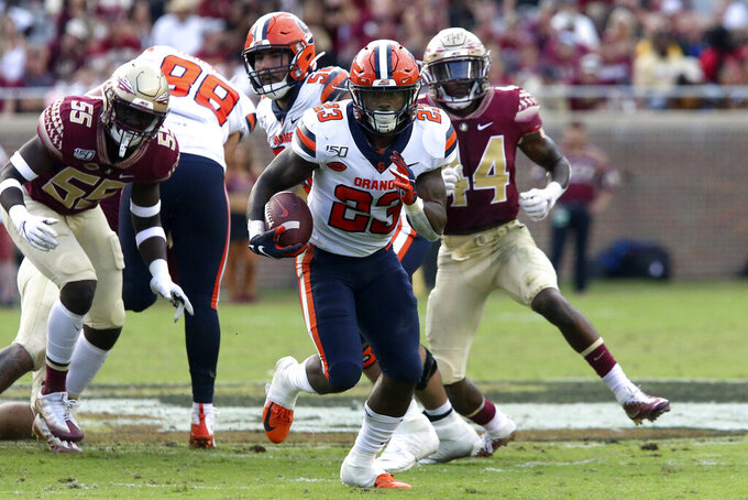 Syracuse's Abdul Adams (23) picks up yardage during the third quarter of an NCAA college football game with Florida State, Saturday, Oct. 26, 2019 in Tallahassee Fla. (AP Photo/Steve Cannon)
