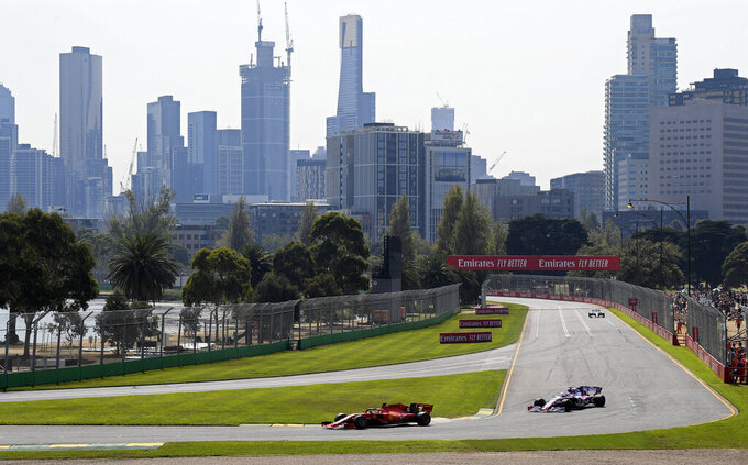 FILE - In this March 16, 2019, file photo, Formula One cars race on the circuit during the final practice session for the Australian Grand Prix in Melbourne, Australia. The 2021 Australian Grand Prix has been canceled after local organizers and Formula One couldn't come up with a compromise over Australia's strict travel and quarantine issues relating to the COVID-19 pandemic. (AP Photo/Andy Brownbill, File)