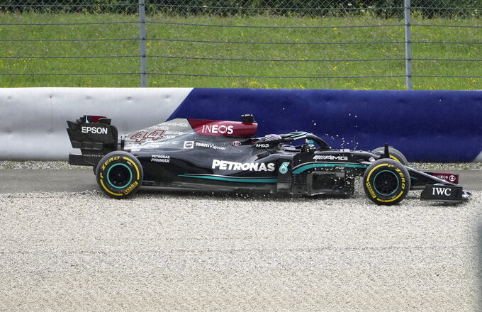 Mercedes driver Lewis Hamilton of Britain goes into the gravel at Turn Four during the second free practice session for the Austrian Formula One Grand Prix at the Red Bull Ring racetrack in Spielberg, Austria, Friday, July 2, 2021. The Austrian Grand Prix will be held on Sunday. (AP Photo/Darko Bandic)