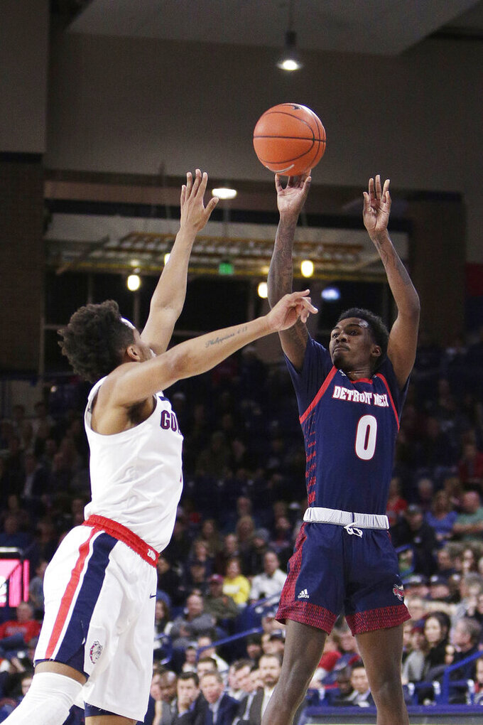 Detroit Mercy guard Antoine Davis, right, shoots over Gonzaga guard Admon Gilder during the second half of an NCAA college basketball game in Spokane, Wash., Monday, Dec. 30, 2019. (AP Photo/Young Kwak)