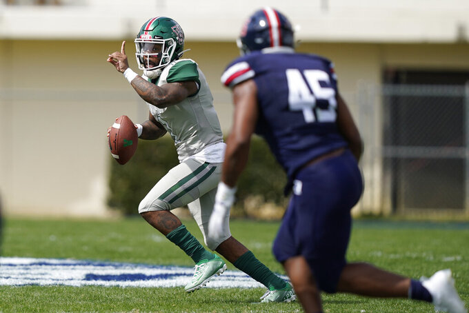 Mississippi Valley State quarterback Jalani Eason (1) attempts to pass against Jackson State linebacker Aubrey Miller Jr., (45) during the second half of an NCAA college football game, Sunday, March 14, 2021, in Jackson, Miss. (AP Photo/Rogelio V. Solis)