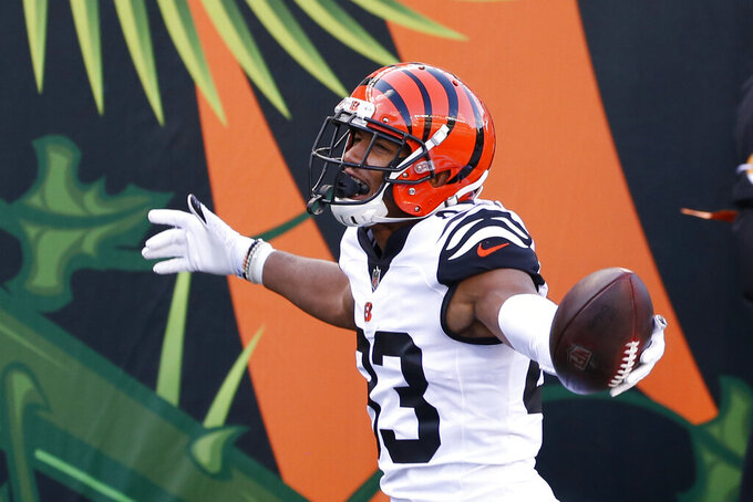 Cincinnati Bengals' Tyler Boyd (83) celebrates a touchdown reception during the second half of an NFL football game against the Tennessee Titans, Sunday, Nov. 1, 2020, in Cincinnati. (AP Photo/Gary Landers)