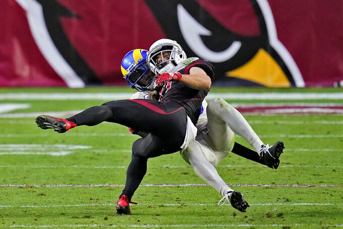 Los Angeles Rams free safety John Johnson, rear, tackles Arizona Cardinals wide receiver Andy Isabella during the second half of an NFL football game, Sunday, Dec. 6, 2020, in Glendale, Ariz. (AP Photo/Ross D. Franklin)