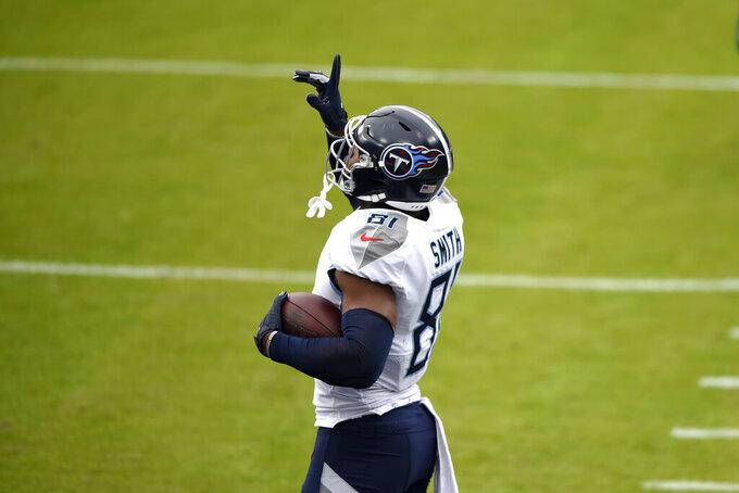 Tennessee Titans tight end Jonnu Smith gestures after catching a touchdown pass from quarterback Ryan Tannehill, not visible, against the Baltimore Ravens during the first half of an NFL football game, Sunday, Nov. 22, 2020, in Baltimore. (AP Photo/Gail Burton)