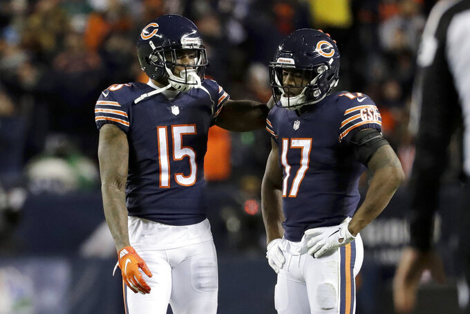 Chicago Bears wide receiver Anthony Miller (17) reacts to play as he talks to Josh Bellamy (15) after officials reviewed an incompete pass ruling during the first half of an NFL wild-card playoff football game against the Philadelphia Eagles Sunday, Jan. 6, 2019, in Chicago. (AP Photo/Nam Y. Huh)