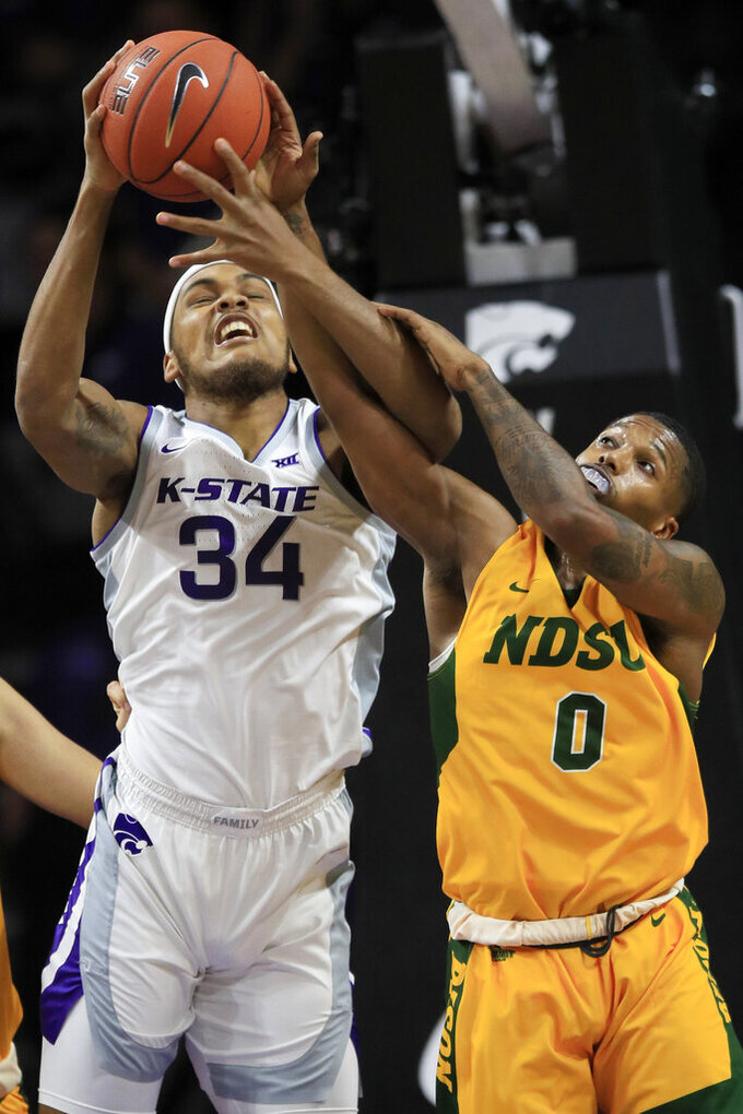 Kansas State forward Levi Stockard III (34) rebounds against North Dakota State guard Vinnie Shahid (0) during the first half of an NCAA college basketball game in Manhattan, Kan., Tuesday, Nov. 5, 2019. (AP Photo/Orlin Wagner)