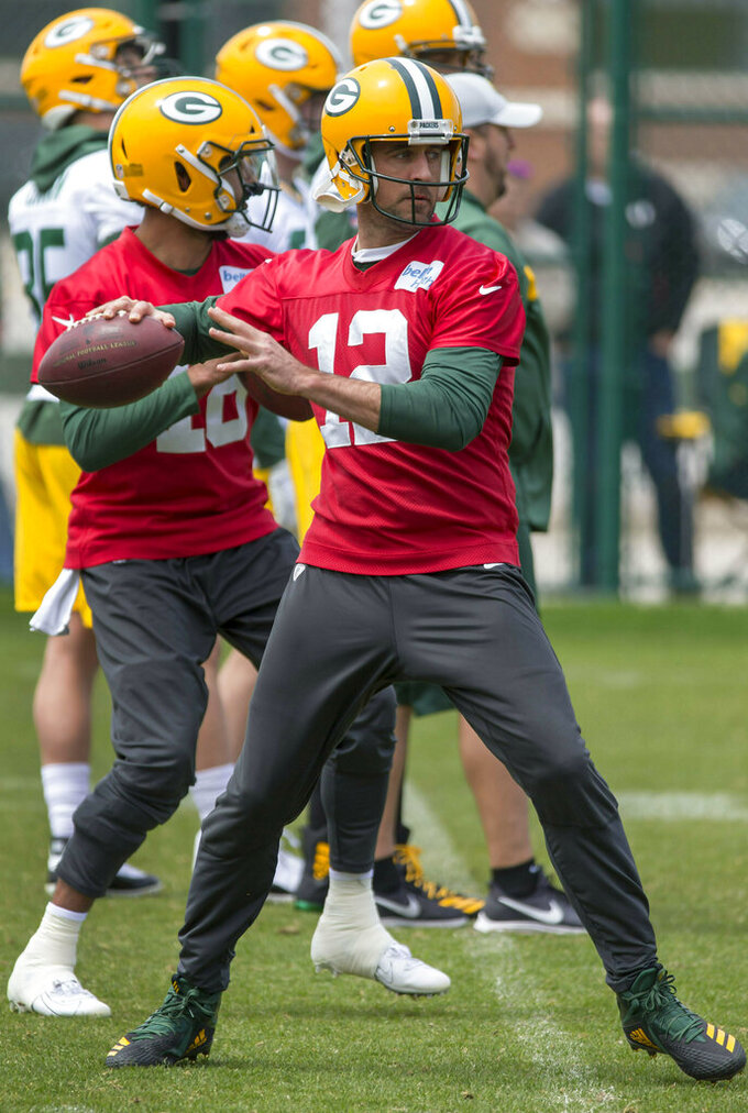 Green Bay Packers quarterback Aaron Rodgers throws during an NFL football practice Tuesday May 21, 2019 in Green Bay, Wis.. (AP Photo/Mike Roemer)