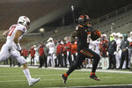 Oregon State running back Jermar Jefferson (6) outruns Washington State linebacker Ron Stone Jr. (10) into the end zone to score a during the second half of an NCAA college football game in Corvallis, Ore., Saturday, Nov. 7, 2020. Washington State won 38-28. (AP Photo/Amanda Loman)