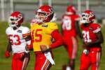 Kansas City Chiefs quarterback Patrick Mahomes (15) runs with teammates during an NFL football training camp Saturday, Aug. 15, 2020, in Kansas City, Mo. (AP Photo/Charlie Riedel)