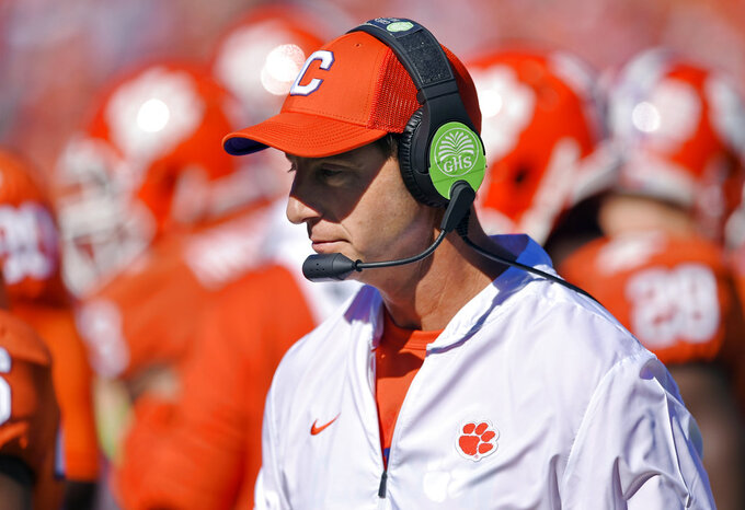 FILE - In this Nov. 3, 2018, file photo, Clemson head coach Dabo Swinney walks the sidelines during the first half of an NCAA college football game against Louisville in Clemson, S.C. There's little question where No. 2 Clemson has a clear edge on Notre Dame: It's playoff experience. The undefeated Tigers are in their fourth straight College Football Playoff while the unbeaten Fighting Irish are in the final four for the first time. (AP Photo/Richard Shiro, File)