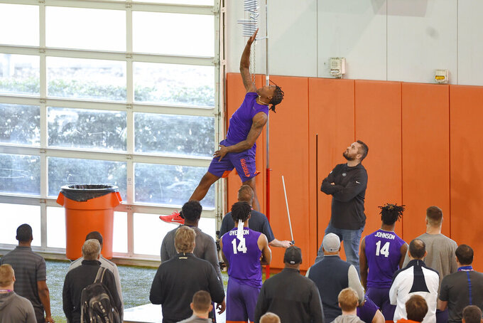 Clemson football player Isaiah Simmons jumps during a drill at NFL Pro Day Thursday, March 12, 2020, in Clemson, S.C. (AP Photo/Richard Shiro)