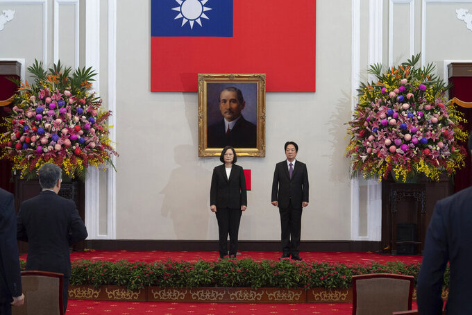 In this photo released by the Taiwan Presidential Office, Taiwanese President Tsai Ing-wen, center stands with Vice-President Lai Ching-te during an inauguration ceremony at the Presidential office in Taipei, Taiwan, Wednesday, May 20, 2020. Tsai was inaugurated for a second term amid increasing pressure from China on the self-governing island democracy it claims as its own territory. (Taiwan Presidential Office via AP)