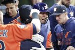 Houston Astros' Yuli Gurriel is congratulated after hitting a home run during the second inning of Game 7 of the baseball World Series against the Washington Nationals Wednesday, Oct. 30, 2019, in Houston. (AP Photo/David J. Phillip)