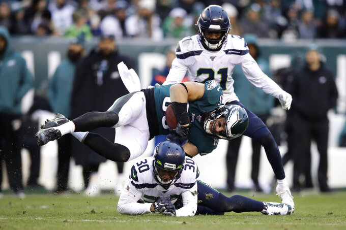 Philadelphia Eagles' Zach Ertz (86) is tackled by Seattle Seahawks' Bradley McDougald (30) during the second half of an NFL football game, Sunday, Nov. 24, 2019, in Philadelphia. (AP Photo/Matt Rourke)