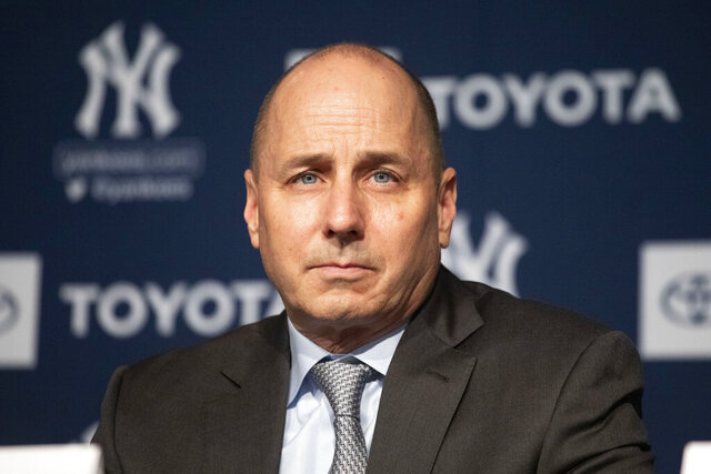 FILE - In this Dec. 18, 2019 file photo, New York Yankees general manager Brian Cashman attends a news conference in New York.    Cashman had suspected that the Houston Astros had been breaking rules against electronic sign stealing long before Commissioner Rob Manfred released his report in January that resulted in three big league managers losing their jobs.