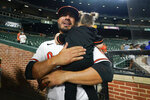 Baltimore Orioles relief pitcher Manny Barreda holds his daughter, Sofia, 2, after he recorded the win during his professional debut in a baseball game against the Kansas City Royals, Wednesday, Sept. 8, 2021, in Baltimore. The Orioles won 9-8. (AP Photo/Julio Cortez)