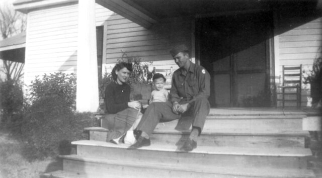 In this image provided by the McConnell Center at the University of Louisville, Mitch McConnell sits with his parents, Julia