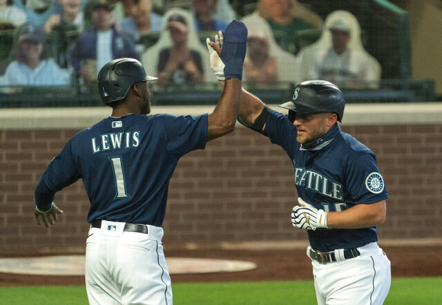 Seattle Mariners' Kyle Seager, right, is congratulated by teammate Kyle Lewis after hitting a two-run home run off of Texas Rangers starting pitcher Kolby Allard that also scored Lewis during the first inning of a baseball game, Monday, Sept. 7, 2020, in Seattle. (AP Photo/Stephen Brashear)