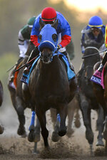 Abel Cedillo aboard Mongolian Groom runs in the Breeders' Cup Classic horse race at Santa Anita Park, Saturday, Nov. 2, 2019, in Arcadia, Calif. Cedillo eased him up near the eighth pole in the stretch. On-call vet says he has
