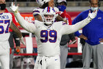 Buffalo Bills defensive tackle Harrison Phillips (99) celebrates a defensive stop against the San Francisco 49ers during the second half of an NFL football game, Monday, Dec. 7, 2020, in Glendale, Ariz. (AP Photo/Ross D. Franklin)