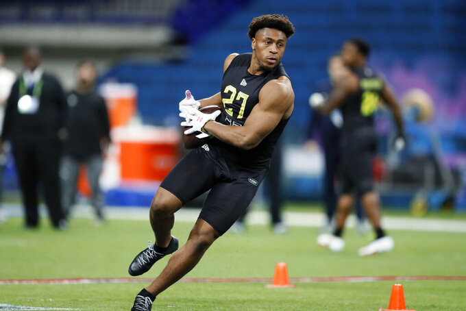 Wisconsin running back Jonathan Taylor runs a drill at the NFL football scouting combine in Indianapolis on Friday, Feb. 28, 2020. (AP Photo/Charlie Neibergall)