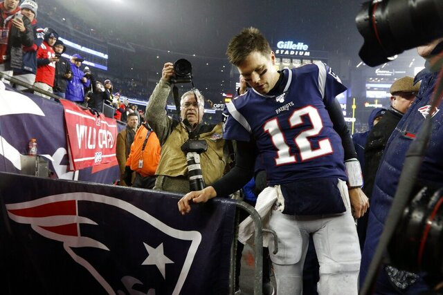 New England Patriots quarterback Tom Brady leaves the field after losing an NFL wild-card playoff football game to the Tennessee Titans, Saturday, Jan. 4, 2020, in Foxborough, Mass. (AP Photo/Bill Sikes)
