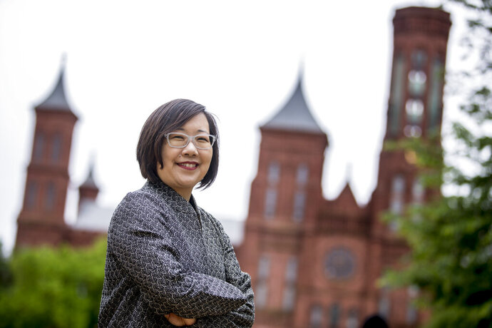 Lisa Sasaki, the director of the Smithsonian Asian Pacific American Center, poses for a photograph in front of the Smithsonian Castle on the National Mall in Washington, Monday, May 13, 2019. On May 18, the Smithsonian Asian Pacific American Center launches a $25 million fundraising drive for permanent gallery space on the National Mall in Washington, D.C. with a glitzy party in Los Angeles full of celebrities and politicians.. (AP Photo/Andrew Harnik)