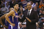 Phoenix Suns head coach Monty Williams, right, talks with Suns guard Devin Booker (1) during the second half of a basketball game against the LA Clippers Saturday, Oct. 26, 2019, in Phoenix. The Suns defeated the Clippers 130-122. (AP Photo/Ross D. Franklin)