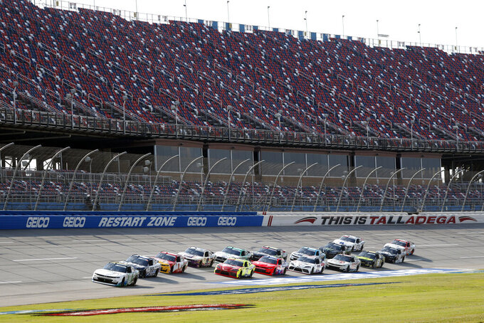 Justin Haley (11) leads the pack in front of empty stands at the start of a NASCAR Xfinity auto race at Talladega Superspeedway in Talladega Ala., Saturday, June 20, 2020. (AP Photo/John Bazemore)