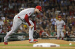 Los Angeles Angels relief pitcher Justin Anderson chases a bunt single by Boston Red Sox's Christian Vazquez during the sixth inning of a baseball game at Fenway Park, Friday, Aug. 9, 2019, in Boston. (AP Photo/Elise Amendola)