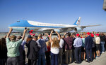 President Donald Trump supporters wave as Air Force One taxies along the runway after landing at Los Angeles International Airport on Tuesday, Sept. 17, 2019 in Los Angeles. (Gina Ferazzi/Los Angeles Times via AP)