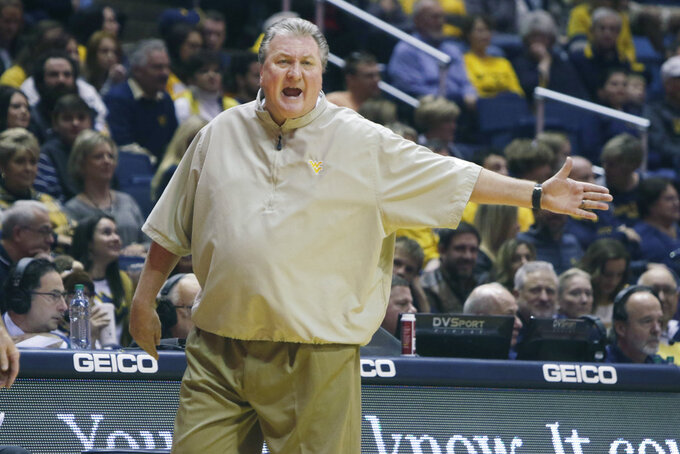 West Virginia head coach Bob Huggins yells at the referees during the first half of an NCAA college basketball game against Lehigh, Sunday, Dec. 30, 2018, in Morgantown, W.Va. (AP Photo/Raymond Thompson)