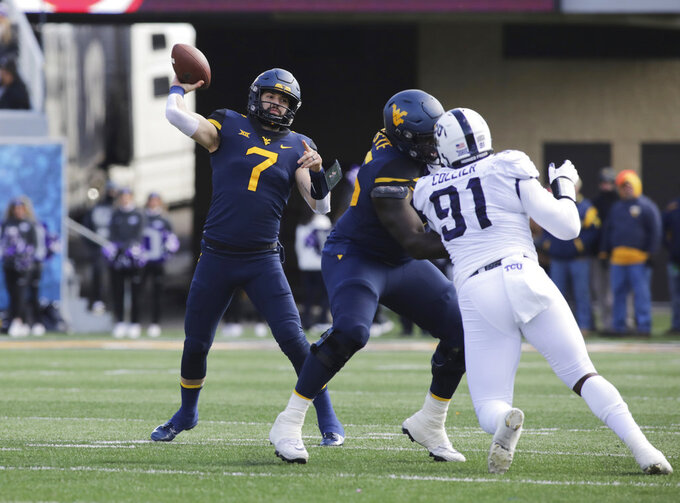West Virginia quarterback Will Grier (7) attempts a pass during the first half of an NCAA college football game against TCU, Saturday, Nov. 10, 2018, in Morgantown, W.Va. (AP Photo/Raymond Thompson)