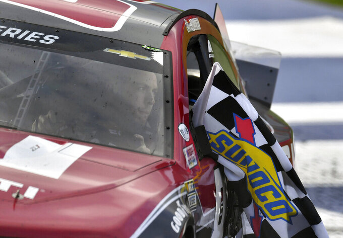 Alex Bowman drives to Victory Lane with the checkered flag after winning a NASCAR Cup Series auto race Sunday, March 1, 2020 in Fontana, Calif. (AP Photo/Will Lester)