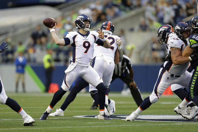 Denver Broncos quarterback Kevin Hogan (9) throws a pass against the Seattle Seahawks during the first half of an NFL football preseason game Thursday, Aug. 8, 2019, in Seattle. (AP Photo/Stephen Brashear)