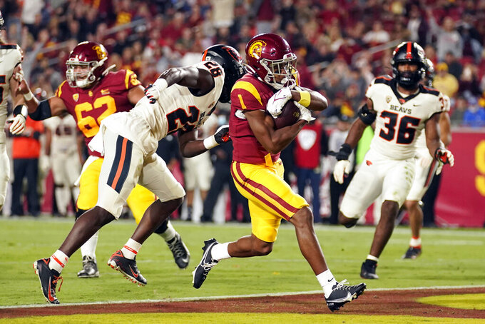 Southern California wide receiver Gary Bryant Jr. (1) scores a touchdown against Oregon State during the first half of an NCAA college football game Saturday, Sept. 25, 2021, in Los Angeles. (AP Photo/Marcio Jose Sanchez)
